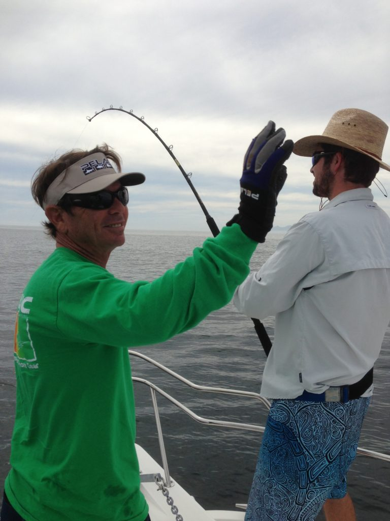 Captain Tony Berkowitz and man catching a marlin in Cabo.