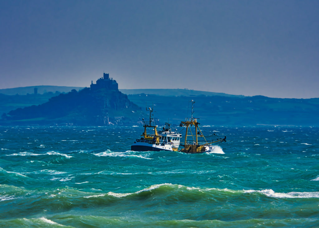 Commercial fishing boat in rough seas.